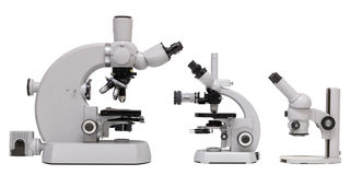 Vintage Microscope family, side view. Vintage Microscope family (isolated), Basic, medium and advanced model side by side stock image