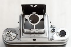 Vintage middle format camera with retro viewfinder opened. This is Pentacon Six middle format camera, top view on a plain white background. The viewfinder is stock photos