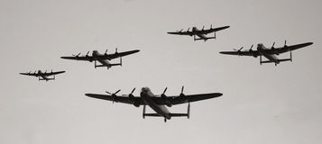 Vintage military aircraft. Vintage military bombers, aircraft in formation royalty free stock photos