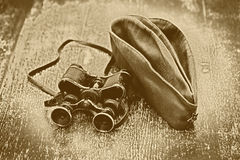 Vintage military binoculars and field cap. Feast of May 9 Victory Day Royalty Free Stock Images