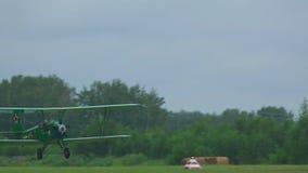 Vintage military biplane take-off stock footage