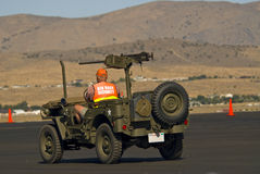Vintage Military Jeep. Man driving a vintage military jeep Stock Photo