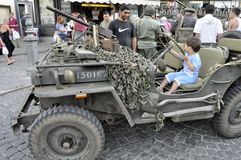 Vintage military jeep driven by a child. Royalty Free Stock Images