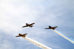 Vintage military planes flying Stock Photos