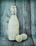 Vintage Milk Bottle and Eggs In Turquoise Barn Royalty Free Stock Image