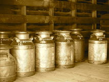 Vintage Milk Cans In Sepia Royalty Free Stock Images