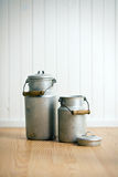 Vintage milk cans. On wooden floor Royalty Free Stock Image