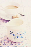 Vintage milk jug, table served for morning coffee Royalty Free Stock Photo