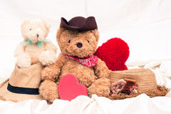 Vintage mini bear and red hart. On white cotton background royalty free stock photo