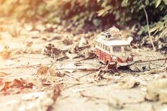 Vintage miniature camper. Vintage miniature hippie camper toy in autumn park stock photo