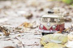 Vintage miniature camper. Vintage miniature hippie camper toy in autumn park stock images