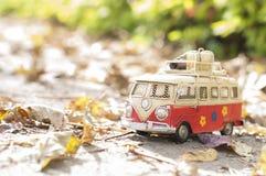 Vintage miniature camper. Vintage miniature hippie camper toy in autumn park stock photos