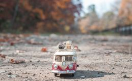 Vintage miniature camper. Vintage miniature hippie camper toy in autumn park royalty free stock photography