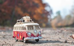 Vintage miniature camper. Vintage miniature hippie camper toy in autumn park stock image