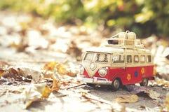 Vintage miniature camper. Vintage miniature hippie camper toy in autumn park royalty free stock photos