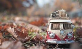 Vintage miniature camper. Vintage miniature hippie camper in autumn park stock photos