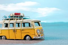 Vintage miniature van on the beach. Travel concept Royalty Free Stock Photo
