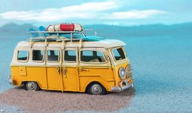 Vintage miniature van on the beach. Travel concept Royalty Free Stock Photography