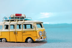 Vintage miniature van on the beach. Travel concept Royalty Free Stock Image