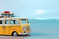 Vintage miniature van on the beach. Travel concept Stock Photo