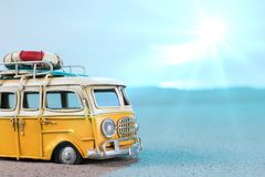 Vintage miniature van on the beach. Travel concept Royalty Free Stock Photos