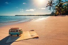 Vintage miniature van and old treasure map on the tropical beach. Travel vintage miniature van and old treasure map on the tropical beach at sunrise, travel stock photos
