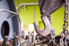 Vintage mining winch empowered by steam engine. Hook Royalty Free Stock Photography
