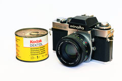 Vintage Minolta XE-5 camera and Kodak Dektol Royalty Free Stock Photo