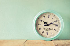 Vintage mint clock on wooden background Stock Photography