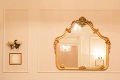 Vintage mirror. Ancient mirror design on the wall stock image