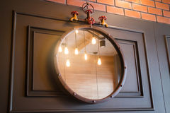 Vintage mirror decorated on old style wall Royalty Free Stock Photo