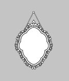 Vintage mirror frame. Hanging on the wall. Rich old frame. Royalty Free Stock Photos