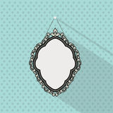 Vintage mirror frame. Hanging on the wall. Rich old frame. Stock Photo