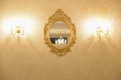Vintage mirror. And lamps. wall decoration royalty free stock photography
