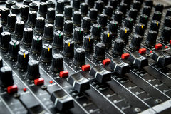 Vintage mixing console. Detail of the buttons and controls on an vintage miximg console Royalty Free Stock Image