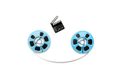 Vintage 8mm blue movie reels and little clapper white background Stock Images