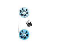 Vintage 8mm blue movie reels and little clapper white background Stock Image