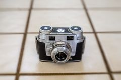 Vintage 35mm film Camera. A vintage 35mm film camera from the 1950`s , still life photo Stock Image