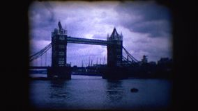 Vintage 8mm footage of London Bridge. Or Tower Bridge over the River Thames stock video footage