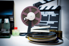 A vintage 8mm movie editing desktop with reels and clapper Royalty Free Stock Images