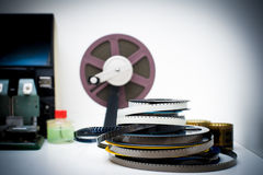 A vintage 8mm movie editing desktop with reels and elements in o Royalty Free Stock Photos