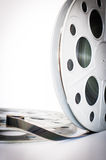 Vintage 35 mm movie film cinema reel on white Royalty Free Stock Photo