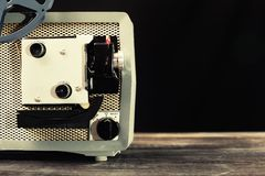Vintage 8mm movie projector on table Royalty Free Stock Photos