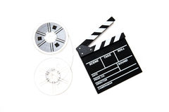 Vintage 8mm movie reels and clapper board white background Royalty Free Stock Photos