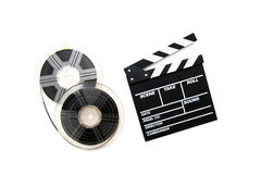 Vintage 8mm movie reels and clapper board white background Royalty Free Stock Photo