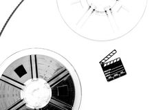 Vintage 8mm movie reels and small clapper board white background Stock Images
