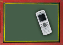 Vintage mobile phone on blackboard Stock Photography