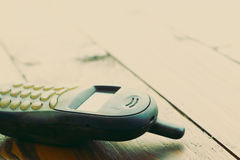 Vintage mobile phone on table background Royalty Free Stock Image