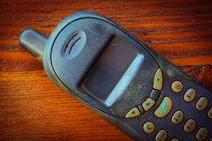 Vintage mobile phone on table background Royalty Free Stock Photography