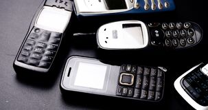 Free Vintage Mobile Phones On A Black Background Stock Photo - 184544460
